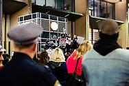 A police officer watches protesters shout slogans and hold up signs at Martin Place during a 'Black Lives Matter' rally on 02 June, 2020 in Sydney, Australia. This event was organised to rally against aboriginal deaths in custody in Australia as well as in unity with protests across the United States following the killing of an unarmed black man George Floyd at the hands of a police officer in Minneapolis, Minnesota. (Photo by Steven Markham/ Speed Media)