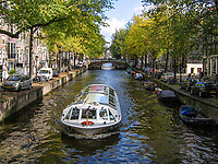 Netherlands, Holland, Amsterdam, canal, canal boat, boat, trees, streets, 200710050079. <br />