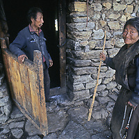 CHINA, TIBET, Tsangpo River Gorge. Husband & wife at home in Trube village, near Kyikar.