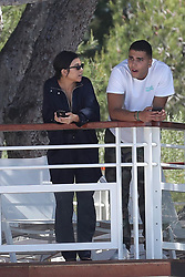 Kourtney Kardashian and Younes Bendjima seen on a balcony together in Cannes, France. 21 May 2017 Pictured: Kourtney Kardashian, Younes Bendjima. Photo credit: Vecio / MEGA TheMegaAgency.com +1 888 505 6342
