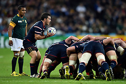 Niku Kruger of the USA looks to put the ball into a scrum. - Mandatory byline: Patrick Khachfe/JMP - 07966 386802 - 07/10/2015 - RUGBY UNION - The Stadium, Queen Elizabeth Olympic Park - London, England - South Africa v USA - Rugby World Cup 2015 Pool B.