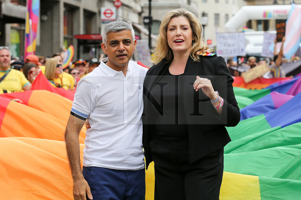 © Licensed to London News Pictures. 06/07/2019. London, UK. Mayor of London Sadiq Khan (L) and Penny Mordaunt Minister for Women and Equalities (R) at the start of  the annual Pride Parade in central London. An estimated over 1 million people lined along the route in support of the LGBT (Lesbian, Gay, Bisexual and Transgender/Transsexual) community. Photo credit: Dinendra Haria/LNP