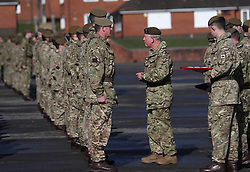 The Prince of Wales presents campaign medals to soldiers from the 1st Battalion Welsh Guards at Elizabeth Barracks in Woking, following their return from Afghanistan.