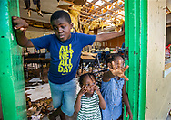 Wajeid Romin, 10, with his sisters Wanita Romin, 2, and Wyomi Romin, 4, at right, took shelter with family at Central Abaco Primary school during Hurricane Dorian at  Marsh Harbour on Abaco Island on Saturday, September 7, 2019. The family is still at the temporary shelter.