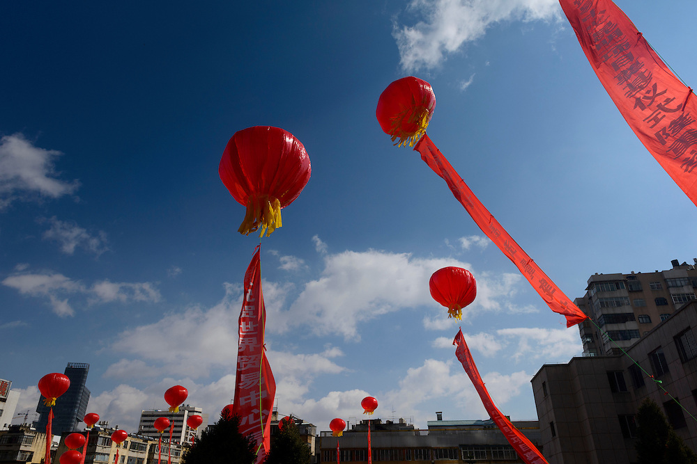 Balloons at a ceremony to lay the foundations for the Kunming World Trade Center, Kunming, Yunnan, China. 5 November 2012.  Kunming has a population of 6.4 million and is the capital of China's Yunnan province.