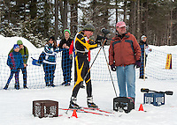 Mark Young of Gilford takes aim at his target while official Ed Valpey tallies the hits during Gunstock Nordic's annual Paintball Biathlon event Sunday morning.  (Karen Bobotas/for the Laconia Daily Sun)