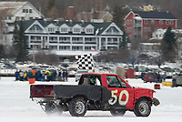 Kyle McDonald in the #50 RWD 4 Cyl class takes a victory lap with the checkered flag during Sunday's Nostalgic Latchkey Cup on Meredith Bay.  (Karen Bobotas/for the Laconia Daily Sun)
