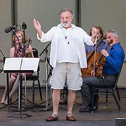 "Mark Morris conducts the American String Quartet, pianist Colin Fowler, trumpet player Sycil Mathai, soprano Yulia Van Doren, mezzo-soprano Jamie Van Eyck, bass-baritone Douglas Williams and the audience in Carl Ruggles' ""Exaltation"" at Libbey Bowl on June 9, 2013 in Ojai, California."