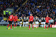 Cardiff city players are left dejected as Southampton players celebrate their 2nd goal scored by Jay Rodriguez. Barclays Premier league, Cardiff city v Southampton at the Cardiff city Stadium in Cardiff,  South Wales on Boxing day, Thursday 26th Dec 2013. <br /> pic by Andrew Orchard, Andrew Orchard sports photography.