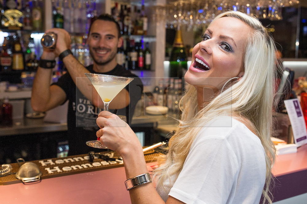 """© Licensed to London News Pictures . FILE PICTURE DATED 08/10/2013 of 47 King Street West restaurant and bar in Manchester .  L-R owner Barry Hymanson (31 from Prestwich) and his partner Zuzana Budveselova (30, from Prestwich) (both correct) at the """"47 King Street West"""" bar's launch event . 47 King Street West has been criticised after staff posted derogatory and insulting comments about its customers on its own Facebook page , in response to a customer criticism . Photo credit : Joel Goodman/LNP"""