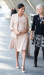 The Duchess of Sussex wearing a pale pink dress and jacket from Brandon Maxwell, visits her first visit as Patron to the National Theatre in London on January 30, 2019,