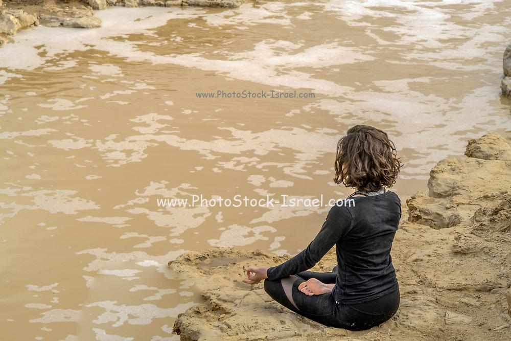 Israel, Negev Desert, woman enjoys the natural power of a flash flood