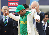 Cricket - 2017 ICC Champions Trophy - Final: Pakistan vs. India<br /> <br /> Pakistan Captain Sarfraz Ahmed is presented with his winners jacket at the Kia Oval.<br /> <br /> COLORSPORT/ANDREW COWIE