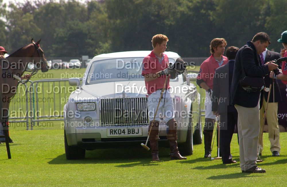 Prince Harry, Cartier International Day at Guard Polo Club, Windsor Great Park. 25 July 2004. SUPPLIED FOR ONE-TIME USE ONLY-DO NOT ARCHIVE. © Copyright Photograph by Dafydd Jones 66 Stockwell Park Rd. London SW9 0DA Tel 020 7733 0108 www.dafjones.com