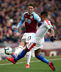 Burnley's Jeff Hendrick (left) and Crystal Palace's Patrick van Aanholt battle for the ball during the Premier League match at Turf Moor, Burnley.