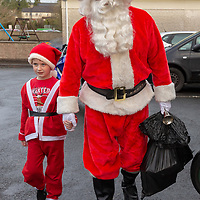 Ryan Cunningham gives santa a helping hand at St Clares school