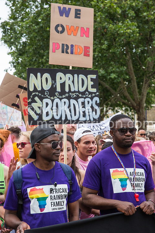 London, UK. 6 July, 2019. Activists from Lesbians and Gays Support The Migrants, African Rainbow Family, the Outside Project, Micro Rainbow and many other LGBT+ groups take part in a London Pride Solidarity March at the very rear of Pride in London - stewards tried to prevent them from joining - in solidarity with those for whom Pride in London is inaccessible and in protest against the corporatisation of Pride in London.