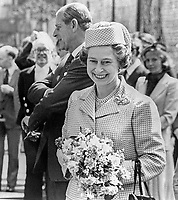 A smiling Queen Elizabeth II during her Silver Jubilee visit to N Ireland. Also in photo is Prince Philip, the Duke of Edinburgh. 197708100074T<br /> <br /> Copyright Image from Victor Patterson, 54 Dorchester Park, Belfast, UK, BT9 6RJ<br /> <br /> t1: +44 28 9066 1296 (from Rep of Ireland 048 9066 1296)<br /> t2: +44 28 9002 2446 (from Rep of Ireland 048 9002 2446)<br /> m: +44 7802 353836<br /> <br /> victorpatterson@me.com<br /> www.victorpatterson.com<br /> <br /> Please see my Terms and Conditions of Use at victorpatterson.com . It is IMPORTANT that you familiarise yourself with them.<br /> <br /> Images used on the Internet incur an additional cost and must be visibly watermarked i.e. ©Victor Patterson within the body of the image and copyright metadata must not be deleted. Images used on the Internet have a size restriction of 4kbs and are chargeable at rates available at victorpatterson.com.<br /> <br /> This image is only available for the use of the download recipient i.e. television station, newspaper, magazine, book publisher, etc, and must not be passed on to any third party. It is also downloaded on condition that each and every usage is notified within 7 days to victorpatterson@me.com<br /> <br /> The right of Victor Patterson to be identified as the author is asserted in accordance with The Copyright Designs And Patents Act (1988). All moral rights are asserted.