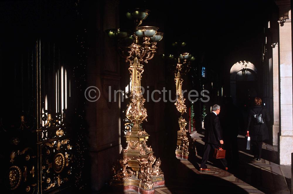 Oversized, golden candelabras in an arcade on the Rue de Rivoli, in the 1st Arrondissement, on 26th April 2008, in Paris France.