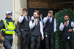 """Waiting staff from the Langham Hotel film the chaos as counter protesters attempt to get at several hundred right wing protesters in central London demanding the release of """"political prisoner"""" right wing talisman Stephen Yaxley-Lennon  - also known as Tommy Robinson, who was imprisoned for contempt of court. London, August 03 2019."""