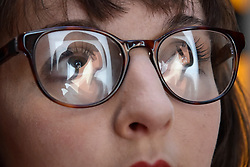 """© Licensed to London News Pictures. 06/10/2017. London, UK.   """"Lucia, back 3"""", 2017, a new work by Julian Opie is reflected in a staff member's glasses at the unveiling of the artwork at the National Portrait Gallery. Photo credit : Stephen Chung/LNP"""