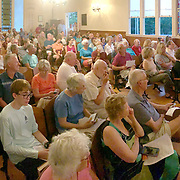 YARMOUTH, Maine -- July 26, 2019 -- Mildred Kenney and Lee Dionne from Cousins Island presented stories of life on Cousins and Littlejohn Islands before the bridge was built at the Cousins Island Chapel this evening. Bob Gifford followed with stories and photos from Littlejohn Island. Guests filled the chapel to standing room only. Photo by Roger S. Duncan  207-443-9665 http://www.rogerduncanphoto.com