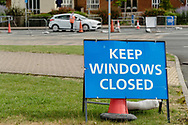 Signs telling people to keep their windows closed outside the stadium prior to the Cardiff City vs Leeds United EFL Championship match at the Cardiff City Stadium, Cardiff, Wales on 21 June 2020.