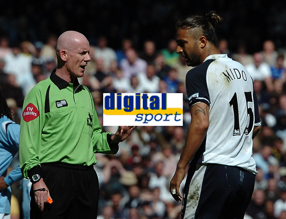 Photo: Ed Godden.<br />Tottenham Hotspur v Manchester City. The Barclays Premiership. 08/04/2006. Referee Dermott Gallagher has a word with Spurs' Mido.