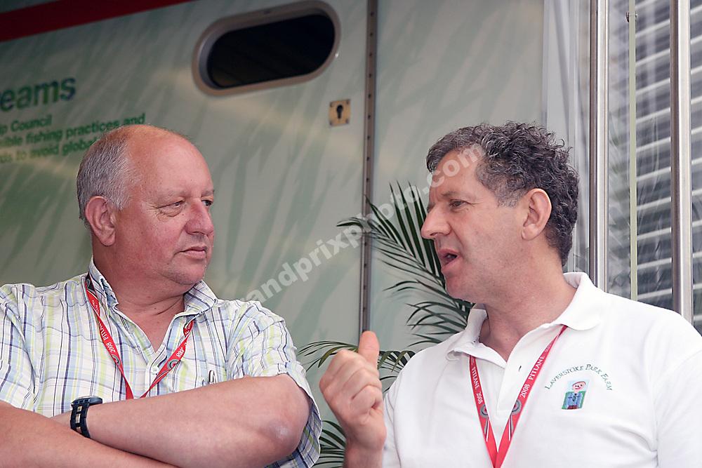 Former world champion Jody Scheckter talking to journalist Dieter Rencken before the 2008 British Grand Prix at Silverstone. Photo: Grand Prix Photo