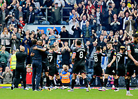 Football - 2021 / 2022 EFL Sky Bet Championship - Blackburn Rovers versus West Bromwich Albion - Ewood Park - Saturday 21st August 2021<br /> <br /> West Bromwich Albion manager Valerian Ismael hugs Kyle Bartley while his players salute their travelling support at the end of the game having taken the three points with a 2-1 win, at Ewood Park.<br /> <br /> COLORSPORT/Alan Martin