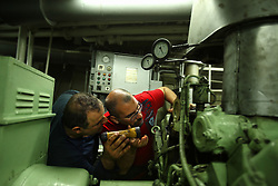 Chief Engineer Gaby Jarjour and Captain Naoum El Hajj, both of Lebanon, check the main generator in the engine room while sailing between Egypt and Lebanon in the Mediterranean Sea on April 10, 2008. The Bisanzio, a feeder ship taking containers from Port Said to Beirut, is Lebanese owned, has three different nationalities aboard, and flies a St. Vincent flag.