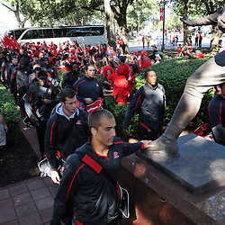 Sep 19, 2009; Piscataway, NJ, USA; Rutgers quarterback Tom Savage   leads his team on the Scarlet Walk before the kickoff of NCAA college football between Rutgers and Florida International at Rutgers Stadium.