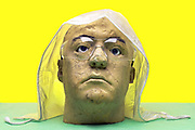 head with transparent plastic rain cover