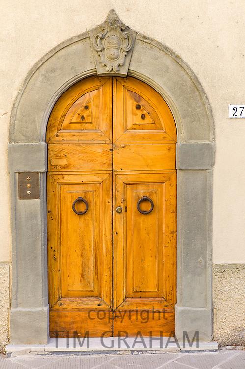 Traditional Tuscan doorway in Piazza Francesco Ferrucci in Radda-in-Chianti, Tuscany, Italy