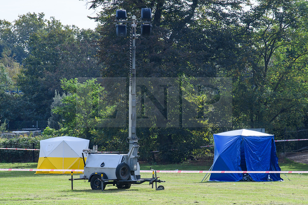 © Licensed to London News Pictures. 13/10/2021. London, UK. Police forensic tents on Craneford Way Playing Fields following the fatal stabbing of a teenager. Police were called at 16:45BST on Tuesday, 12 October to reports of a stabbing in Craneford Way, Twickenham. Metropolitan Police Service (MPS) and London Ambulance Service (LAS) attended. They found an 18-year-old man who is believed to have sustained knife wounds. He was taken by LAS to an outer London hospital where he was pronounced dead at 17:54BST. Photo credit: Peter Manning/LNP