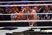 Dean Ambros picks up a bat in a match against Brock Lesnar during WrestleMania on April 3, 2016 in Arlington, Texas.