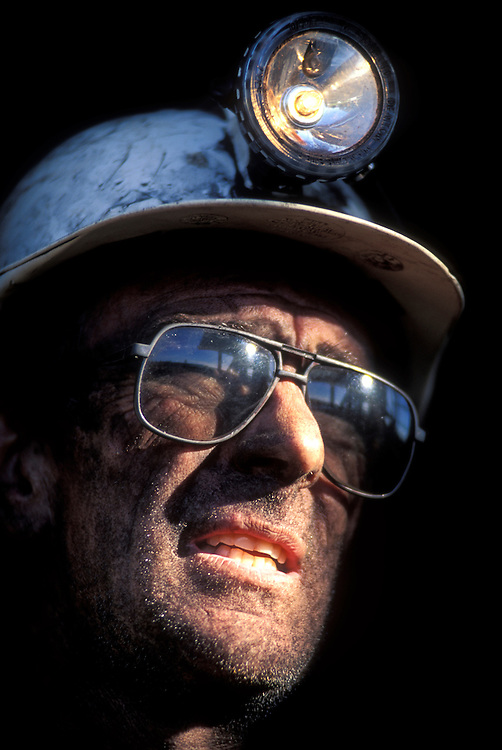 Australia, New South Wales, (MR) Mike Rounce squints at sun after overnight shift at Macquarie Coal's Teralba Colliery in Newcastle.