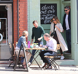 Manchester United's Juan Mata goes for an early coffee in Altrincham Town Centre on Monday morning with his partner Evelina Kamph and a friend.