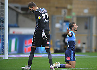 Football - 20230 / 2021 Sky Bet Championship - Wycombe Wanderers vs Millwall - Adams Park Stadium<br /> <br /> Millwall goalkeeper, Bartosz Bialkowski tries to dribble his way out of trouble but is caught by Scott Kashket who scores his first half goal<br /> <br /> <br /> COLORSPORT/ANDREW COWIE