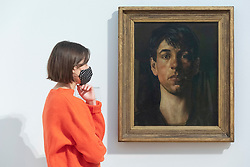 © Licensed to London News Pictures. 15/10/2020. London, UK. Self-portrait painting (1914) by artist Stanley Spencer is displayed as part of the Tate Britain's new collection displays inviting visitors to follow a route inside the venue. Photo credit: Ray Tang/LNP