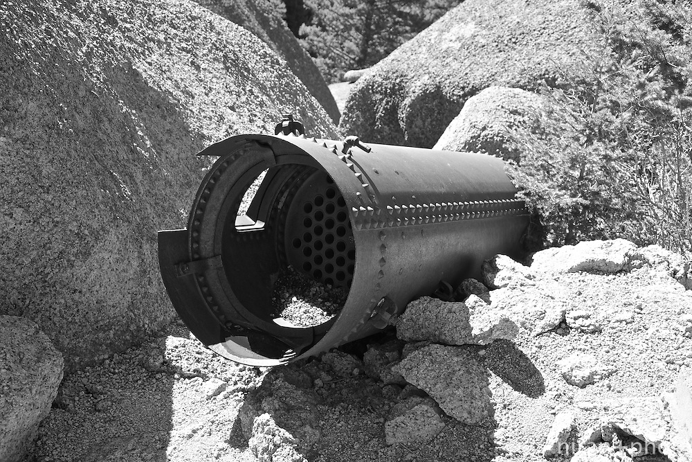Remnant of the failed attempt at damming the Lost Creek. This pipe appears to be a water flow regulator of sorts abandoned at the Shaft House site,