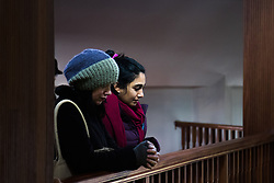 "Finsbury Park Mosque, London, February 7th 2016. Two women watch Muslim men pray from an upper balcony as part of a Visit My Mosque initiative by the Muslim Council of Britain to show non-Muslims ""how Muslims connect to God, connect to communities and to neighbours around them"".<br /> . ///FOR LICENCING CONTACT: paul@pauldaveycreative.co.uk TEL:+44 (0) 7966 016 296 or +44 (0) 20 8969 6875. ©2015 Paul R Davey. All rights reserved."