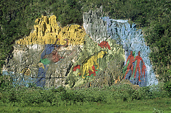 Mural painted on the side of a Mogote or limestone outcrop near Vinales; Cuba,