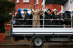 © London News Pictures. 24/03/2016.  A group of young Orthodox Jewish men, some in fancy dress,  ride in the back of a truck while listening to music as they  celebrate the festival of Purim in the streets of Stamford Hill in north London. Purim celebrates the miraculous salvation of the Jews from a genocidal plot in ancient Persia, an event documented in the Book of Esther. Traditionally the jewish community wear fancy dress and exchange reciprocal gifts of food and drink. Photo credit: Tolga Akmen/LNP