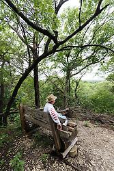 Hiker enjoying view from Piedmont Ridge, Great Trinity Forest, Dallas, Texas, USA