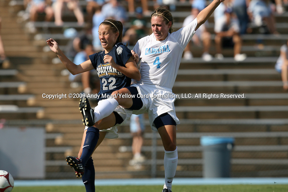 30 August 2009: North Carolina's Meghan Klingenberg (4) and Greensboro's Heather Mitrisin (22). The University of North Carolina Tar Heels defeated the University of North Carolina Greensboro Spartans 1-0 at Fetzer Field in Chapel Hill, North Carolina in an NCAA Division I Women's college soccer game.
