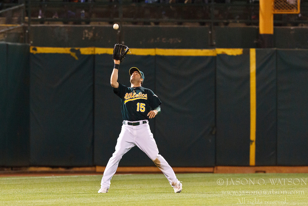 OAKLAND, CA - JUNE 20: Seth Smith #15 of the Oakland Athletics catches a fly ball hit off the bat of Tony Gwynn #10 of the Los Angeles Dodgers (not pictured) during the eighth inning of an interleague game at O.co Coliseum on June 20, 2012 in Oakland, California. The Oakland Athletics defeated the Los Angeles Dodgers 4-1. (Photo by Jason O. Watson/Getty Images) *** Local Caption *** Seth Smith