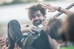 Foals frontman Yannis Philippakis. Radio One, Sunday, T in the Park 2013.<br /> ©Michael Schofield.