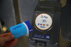 An Oyster card is used with contactless payment at a tube station in London. Issue date: Friday March 27, 2020. Photo credit should read: Isabel Infantes/EMPICS Entertainment