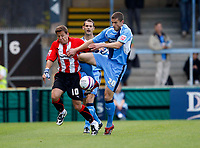 Photo: Richard Lane/Richard Lane Photography. Wycombe Wanderers v Brentford. Coca Cola Fotball League Two. 13/09/2008. Wycombe's John Mousinho and Brentford's Charlie MacDonald (lt) challenge for the ball.